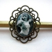 exotic dancer brooch with ornate brass base