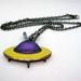 Retro spaceship necklace