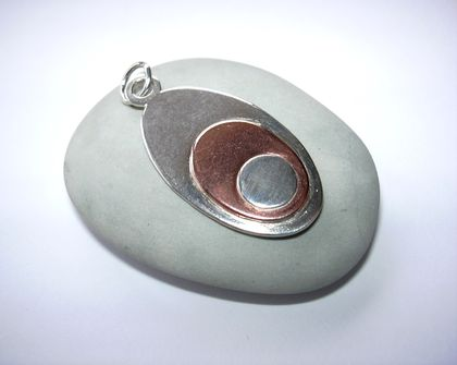 Oval silver and copper pendant