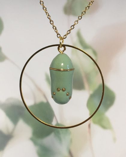 STYLISED MONARCH CHRYSALIS - encircled in gold