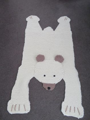 Knitted polar bear rug