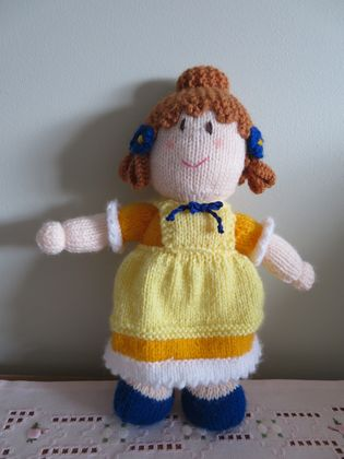 Gorgeous handknitted girl doll