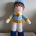 Gorgeous hand knitted boy doll