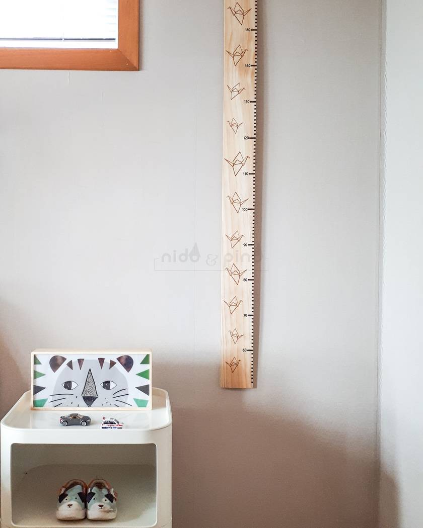 Origami crane height chart natural background