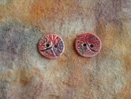 Two handmade ceramic buttons, red lace