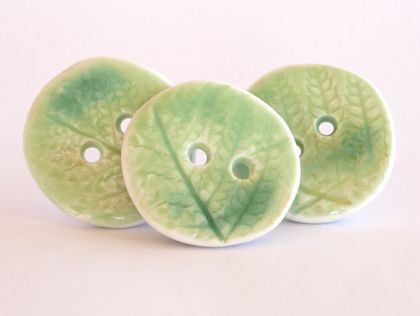 Three handmade ceramic buttons, green fern