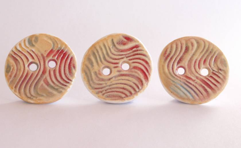 Three handmade ceramic buttons, swirl design