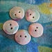 Five handmade ceramic buttons, scallop shells