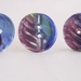 Three handmade ceramic buttons, blue leaf design