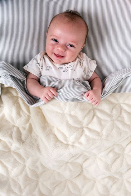 Sojourn: SevenTreasures Handwoven New Zealand wool baby blanket for cot