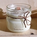 Small mason jar wood wick scented soy candle.