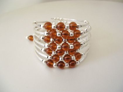 Amber and silver wrap bracelet : memory wire wrap bracelet of amber and silver toned beads