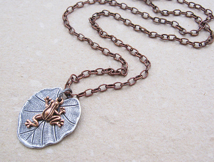 Lily Pad necklace: a small copper frog charm on a silver lily-pad pendant