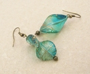 Forest Sunlight earrings: translucent, green and blue twist beads with gold streaks