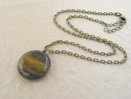 Simple, semiprecious, round tiger-eye pendant on textured, antiqued-brass chain