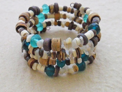 Coconut Beach bracelet: memory wire wrap bracelet with moonstone, coconut, wood, and sea-green glass