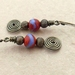 Hammered Spiral Earrings #1: antiqued-brass coloured wire earrings with red and blue glass beads