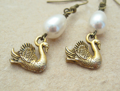 Swans' Eggs: unique Swarovski pearl earrings with gold swan charms – elegantly ornithological
