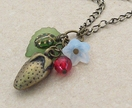 Wild Strawberry: nature-inspired cluster necklace with ladybird