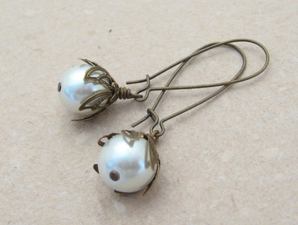White Buds earrings: glass pearls with leafy bronze caps on long ear-wires