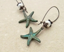 Starfish Treasure earrings in verdigris: lifelike, patinated starfish charms with white faux pearls