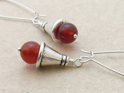 Carneole earrings: silver-capped, deep orange carnelian beads hung from silver plated ear-wires