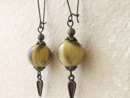 Wildcat earrings: tiger-patterned lucite beads with antiqued brass metals on long ear-wires