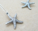 Silver Starfish earrings: lifelike, double-sided, antiqued silver starfish charms on long ear-wires