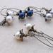 Bursting Bud earrings in cream: floral earrings featuring Swarovski pearls on long ear-wires