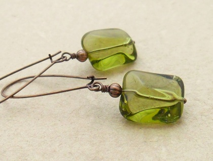 Lin earrings in peridot green: simple, smooth glass beads on long copper ear-wires