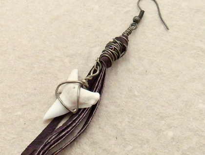Shark Tooth Earring #1: a single long earring of dark brown leather, with repurposed shark tooth