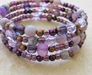 Purple Dusk bracelet: memory wire wrap bracelet in gleaming purple, mauve, and antiqued copper