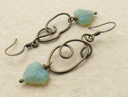 Curly Vine earrings: little, milky green glass leaves dangling from curling wire