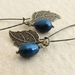 Pearl Berry earrings in deep peacock blue: Swarovski pearls with bronze-coloured leaves