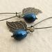 Pearl Berry earrings in deep peacock blue: Swarovski pearls with bronze-coloured leaves