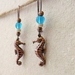 Burnished Ocean earrings: antiqued-copper seahorses with coconut shell and blue glass