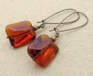Lin earrings in toffee brown: simple, smooth glass beads on long copper ear-wires