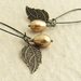 Pearl Berry earrings in gold: Swarovski pearls with bronze-coloured leaves on long ear-wires