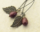 Pearl Berry earrings in burgundy: Swarovski pearls with bronze-coloured leaves