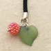 Wild Raspberry cellphone charm – acrylic raspberry bead with green leaf on black braided strap