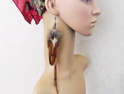Alon: a single long earring of cruelty-free cockerel feathers and upcycled brown leather