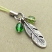 Forest Feather cellphone charm with sparkly green glass beads and green strap