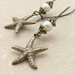 Starfish Treasure earrings in brass: lifelike, antiqued-brass starfish charms with white faux pearls