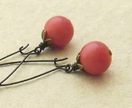 Cranberry earrings: vintage, light red beads on bronze ear-wires