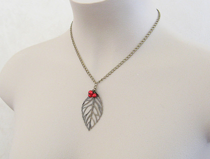 Woodland Berries: Autumnal skeleton-leaf necklace with red berry cluster