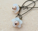 Cherry Blossoms earrings: dainty white glass flowers with pearl centres on long ear-wires