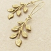 Gilded Twig earrings: raw brass leaf drops on gold-plated ear-wires