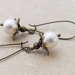 Bursting Bud earrings in white: floral earrings featuring Swarovski pearls on long ear-wires