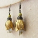 Kowhai earrings: large brass flowers with yellow-beaded stamens on short hooks