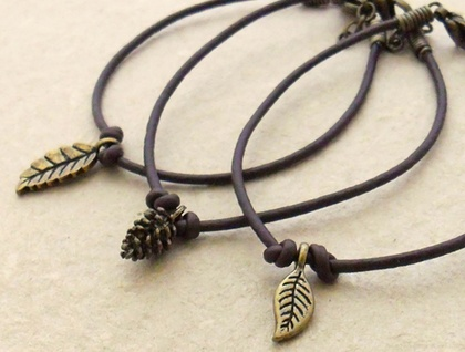 Your choice of dark brown faux leather bracelet with antiqued-brass charm: Pinecone, Small Leaf #1, or Small Leaf #2